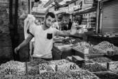 Nut Vendor Machane Yehuda Market BW 1481 by Bob Neiman
