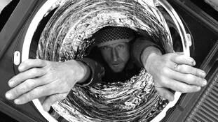Man in Tube by Bil Laschke
