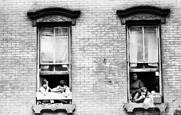 Two Kids in Left Window & Two Kids and Their Mom in the Right by Jack Feder