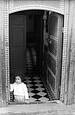 Morrocan Girl Inside Doorway with Tiled Floor by Jack Feder