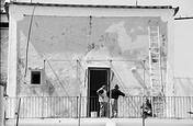 Men Painting Building in Ischia Italy by Jack Feder