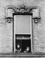 Two Girls in Window with Mouths Open by Jack Feder