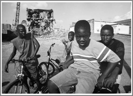 Five boys at common street demolition