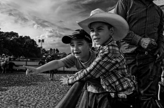 Two boys watching the cowboys