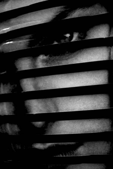 Man behind stripes