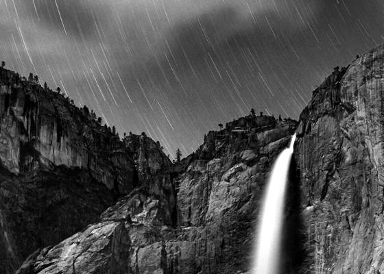 Star trails over yosemite falls
