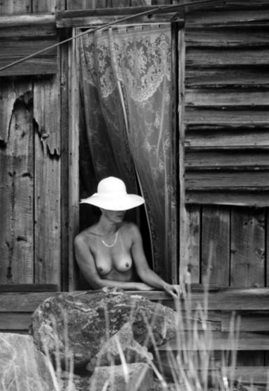 Women in cabin window