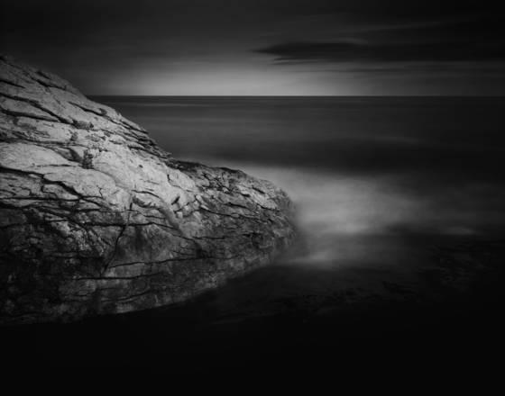Dark ocean and boulder