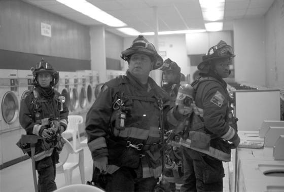 Firemen at the laundromat