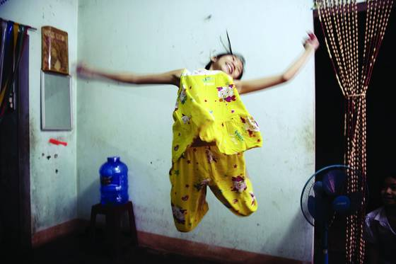 Child jumping in a home built on de mined ground