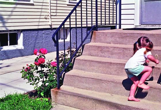 Little girl roses dandilion