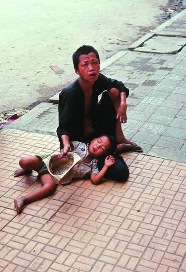 Crippled beggar with child