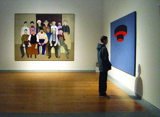 Man viewing painting