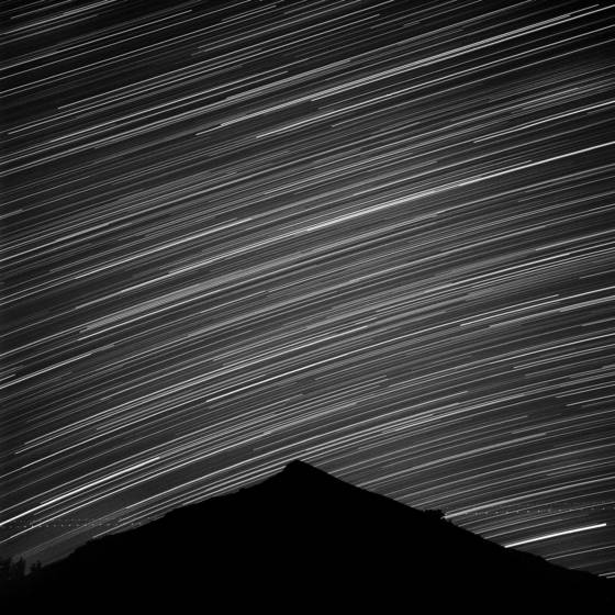 Star tracks over black mountain