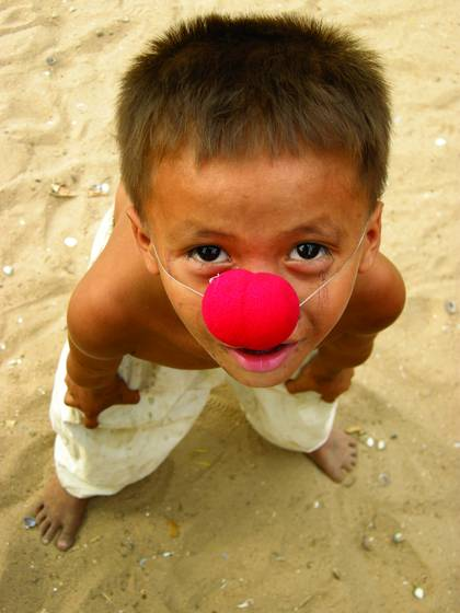 Little clown boy in the slum
