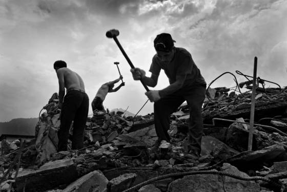 Villagers salvaging metal after sichuan earthquake