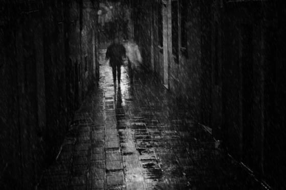 Couple walking in venice rain