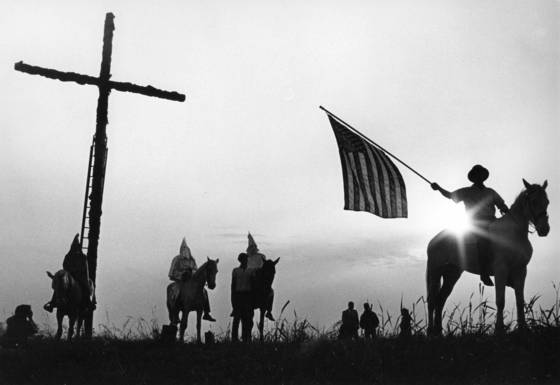 Horsemen waving american flag
