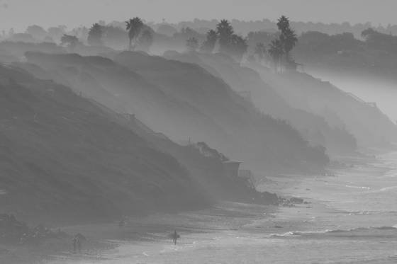 Surfer in morning mist