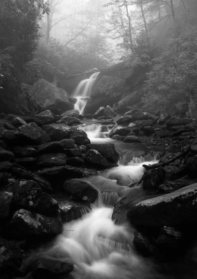Grotto falls in fog