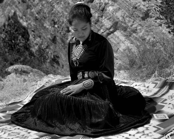 Navajo girl against rocks