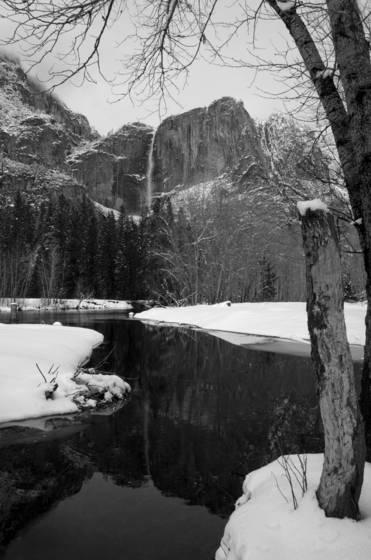 Reflection of winter yosemite fall