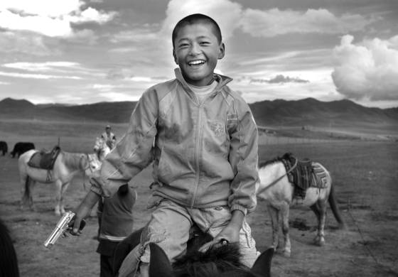 Xiahe boy with gun china 2008