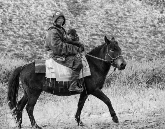 Nomadic horseman and child