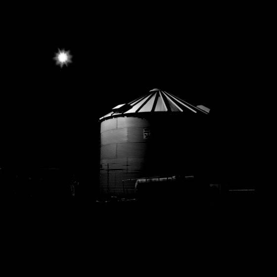 Grain bin at night