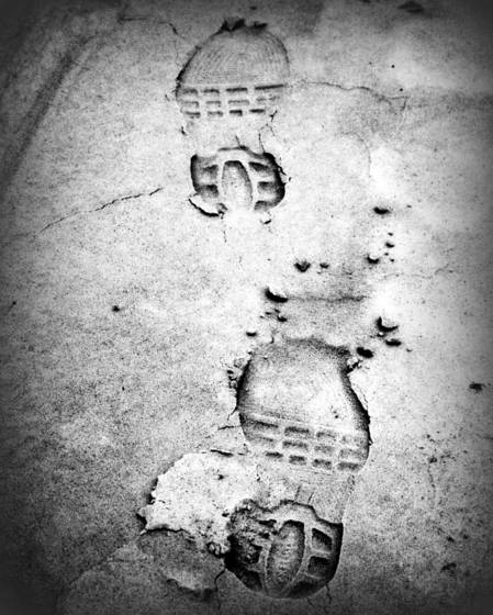 Footprints orange beach