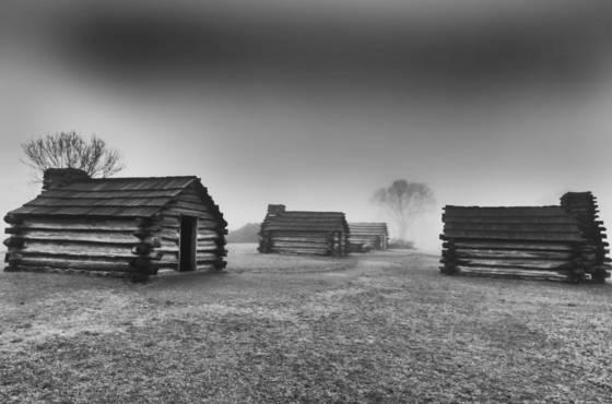 Huts in fog