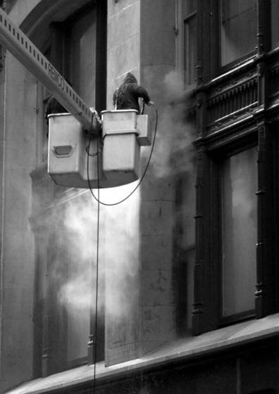 Steam cleaning a building