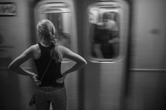 Woman waiting on subway