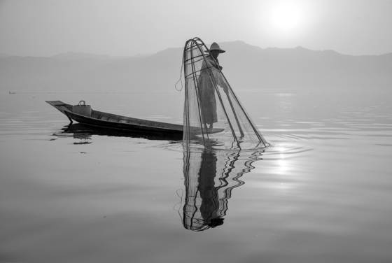 Man with fish trap