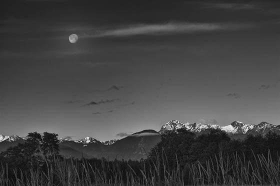 Setting moon and olympic mountains