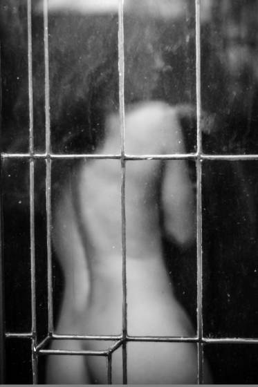 Nude through aged glass