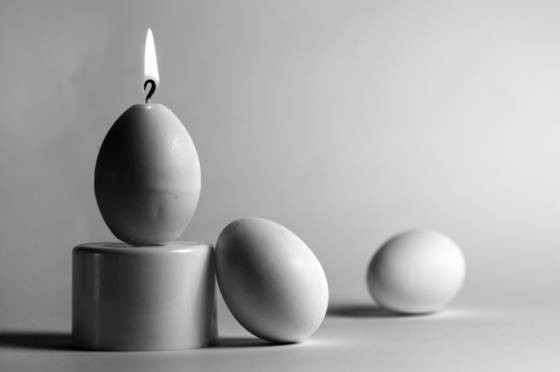 Egg candle and two eggs