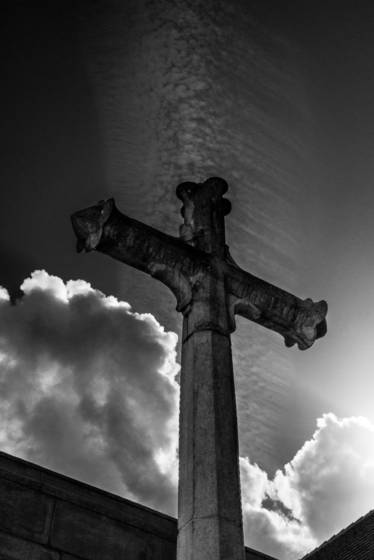 Contrail above the cross