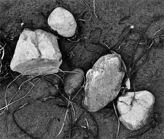 White stones on sand