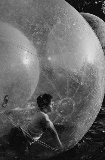 Boy in balloon ball