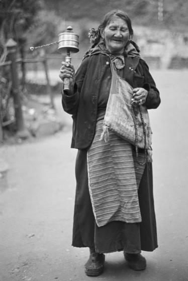 Tibetan refuge with prayer wheel