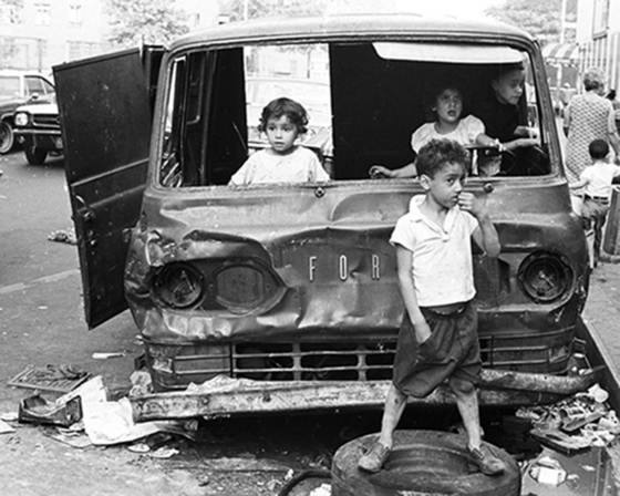 Kids playing in abandoned car