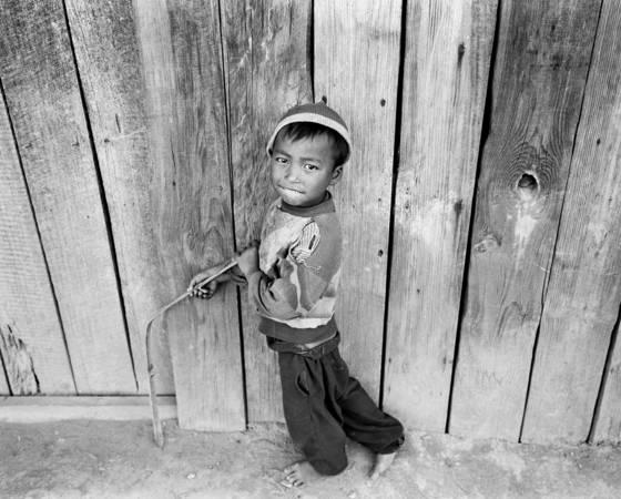 Boy wielding bamboo