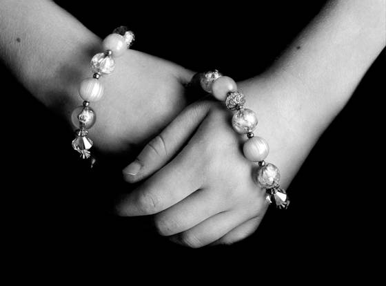 Hands and necklace