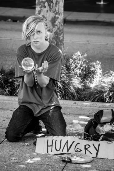 Hungry juggler with crystal ball