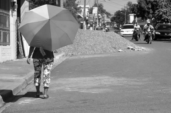 Using umbrella on sunny day