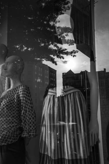 Reflections against manikin in window