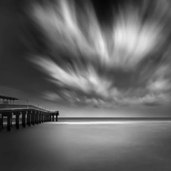 Pier clouds ocean