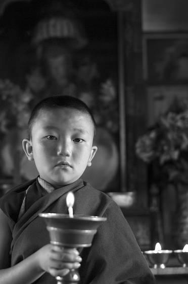 Reincarnated tulku with butter lamp