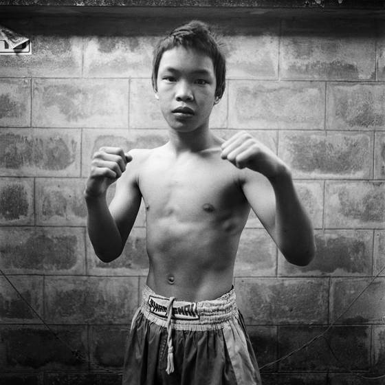 Young boxer before training